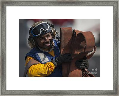 Aviation Boatswains Mate  Carrying Framed Print by Stocktrek Images