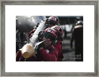 Aviation Ordnancemen Carry An Framed Print by Stocktrek Images