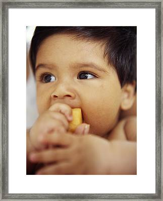 Baby Boy Eating Framed Print by Ian Boddy