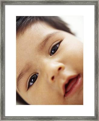 Baby Boy's Face Framed Print by Ian Boddy