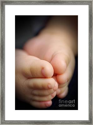 Baby Feet Framed Print by Carlos Caetano
