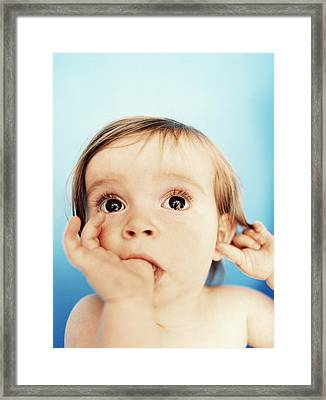 Baby Girl Sucking Thumb Framed Print by Ian Boddy