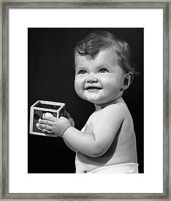 Baby Holding Block Framed Print by George Marks