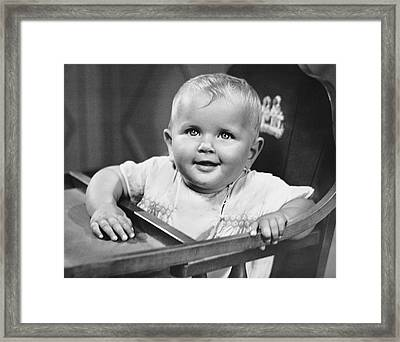 Baby In Highchair Framed Print by George Marks