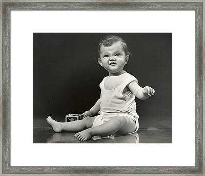 Baby Making Funny Face Framed Print by George Marks