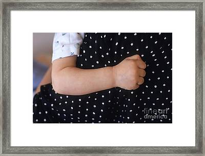 Baby S Arm On Mother S Back Framed Print by Sami Sarkis