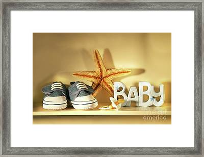 Baby Shoes On The Shelf Framed Print by Sandra Cunningham