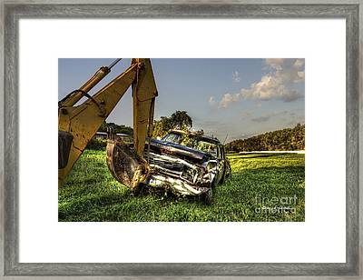 Backhoe Pulling Car Out Of Field Framed Print by Dan Friend