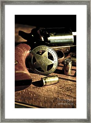 Badge And Gun Framed Print