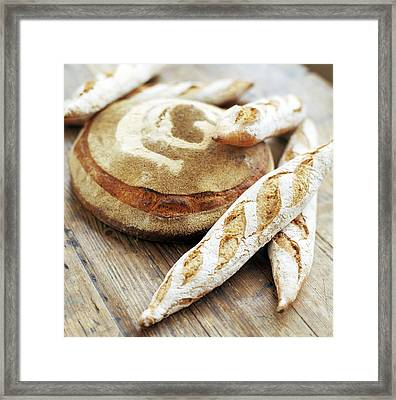 Baguettes And A Loaf Of Bread Framed Print