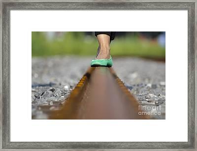 Balance With Her Feet Framed Print