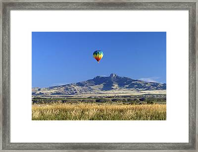 Balloon Over Heart Mountain Framed Print by Lora Ballweber