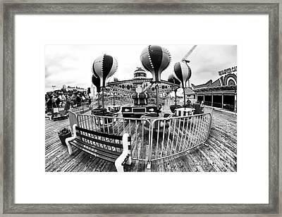 Balloon Ride At Seaside Framed Print by John Rizzuto
