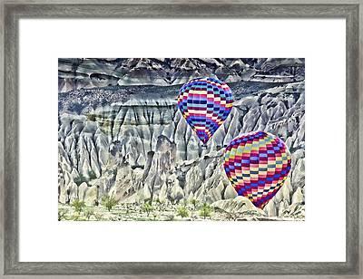 Balloon Rides In Cappadocia Framed Print by Beverly Hanson