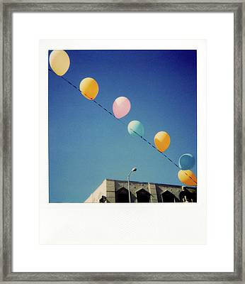 Balloons Framed Print by Nicole Apatoff