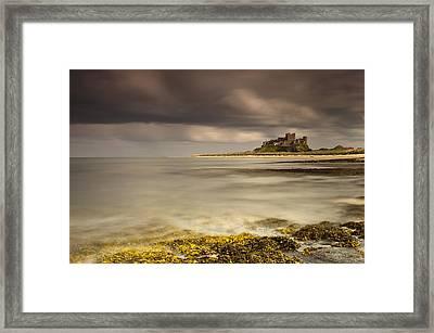 Bamburgh Castle Under A Cloudy Sky Framed Print