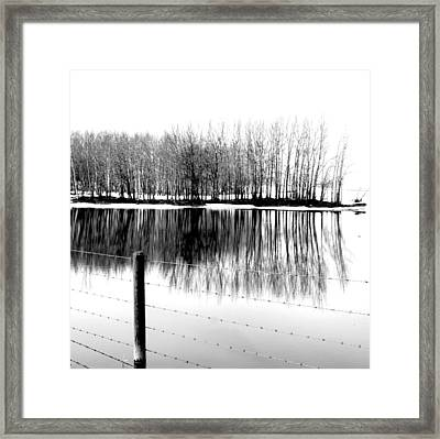 Barbed Water Framed Print by Empty Wall