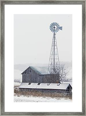 Barn And Windmill In Snow Framed Print by Larry Ricker