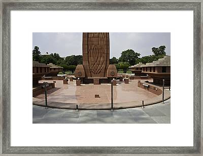 Framed Print featuring the photograph Base Of The Jallianwala Bagh Memorial In Amritsar by Ashish Agarwal