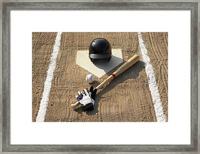 Baseball, Bat, Batting Gloves And Baseball Helmet At Home Plate Framed Print by Thomas Northcut
