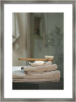 Bath Brush On Stacked Towels Framed Print