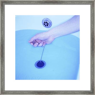 Bath Plug Being Pulled Framed Print by Cristina Pedrazzini