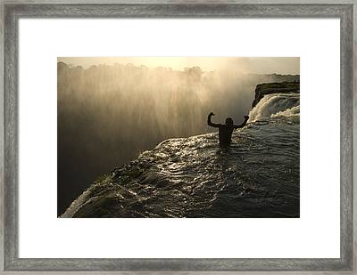 Bathing In A Swimming Hole At The Top Framed Print by Annie Griffiths