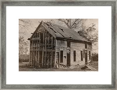 Battered And Leaning Framed Print
