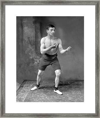 Battling Taylor Framed Print by Reinhold Thiele