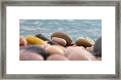 Beach And Stones Framed Print