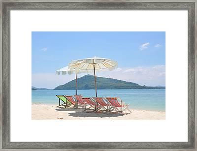 Beach Chair And Umbrella On Beach Framed Print