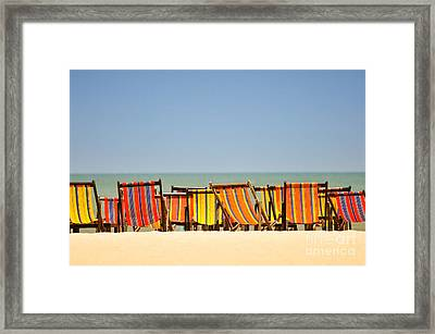 Beach Chairs Colorful  Framed Print by Panupong Roopyai