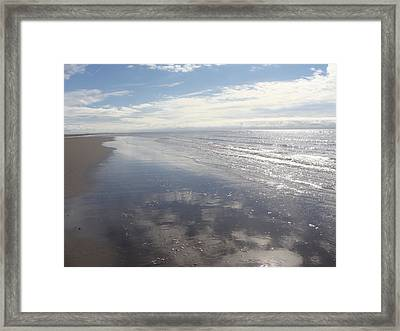 Beach Clouds Framed Print by Emma Manners