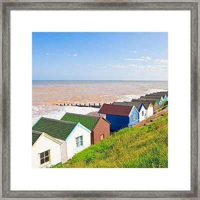 Beach Huts Framed Print by Tom Gowanlock