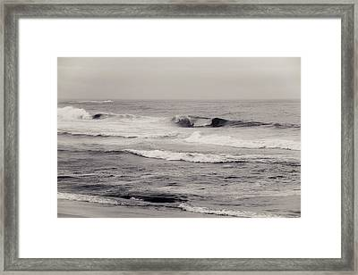 Beach On A Rainy Day Framed Print by Ezequiel Rodriguez Baudo