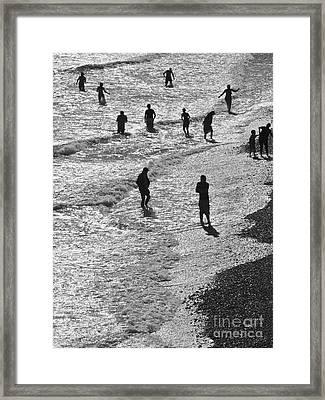 Beach Walkers 2 Framed Print by Tim Bird