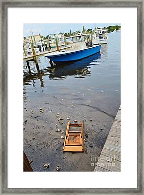 Beached Chair Framed Print