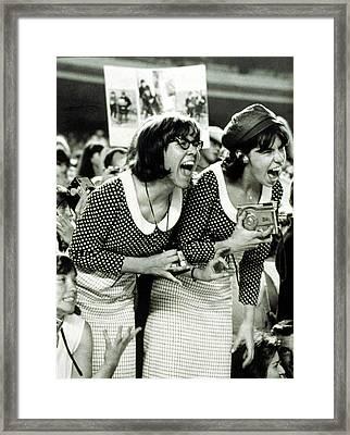 Beatles Fans Scream At A Concert Framed Print by Everett