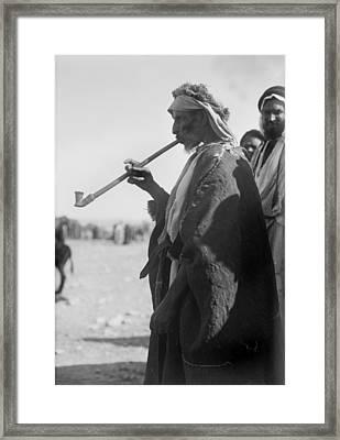 Bedouin Man Smoking A Long Pipe Framed Print by Everett