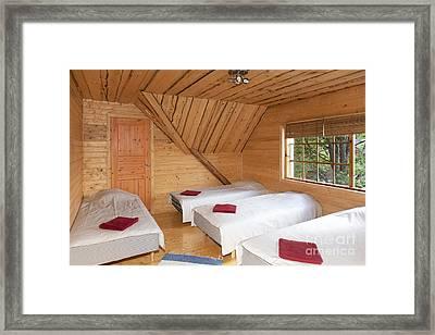 Beds In A Wooden Bedroom Framed Print