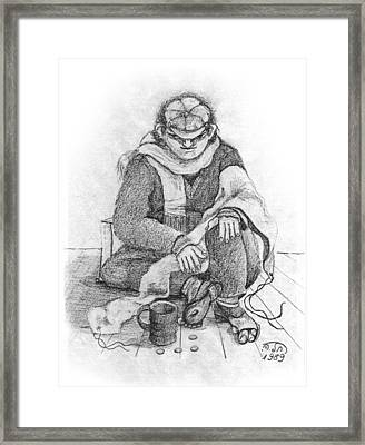 Beggar 2  In The  Winter Street Sitting On Floor Wearing Worn Out Cloths Framed Print