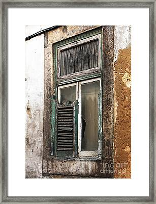 Behind The Green Shutter Framed Print by John Rizzuto