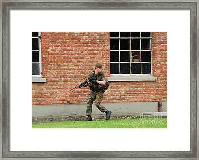 Belgian Infantrists Under Attack Framed Print by Luc De Jaeger