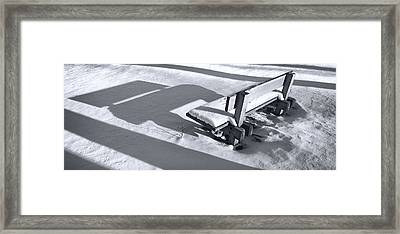 Bench In Snow Framed Print by Ercole Gaudioso