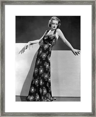 Bette Davis Wearing Crepe Yellow Framed Print by Everett
