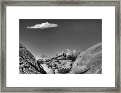 Between A Rock Framed Print