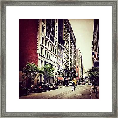 Bicycle And Buildings In New York City Framed Print