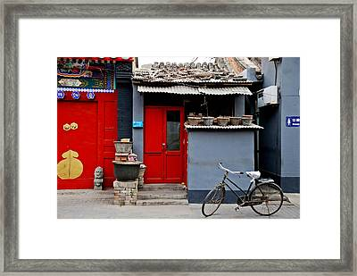 Bicycle And Red Door Framed Print