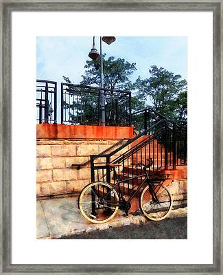 Bicycle By Train Station Framed Print by Susan Savad