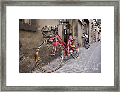 Bicycles Parked In The Street Framed Print by Jeremy Woodhouse